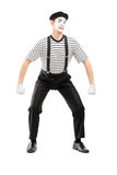 Mime artist lifting something imaginary Royalty Free Stock Photo