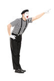 Mime artist pointing up with his hand Stock Image
