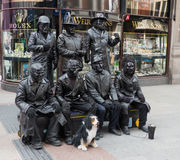 Mime artists in Grafton Street in Dublin City. A group of mime artists with their model dog performing in Grafton Street in Dublin City. Their black outfits and Royalty Free Stock Photo