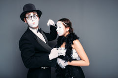 Mime artists with white makeup masks on faces Royalty Free Stock Photos