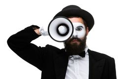Mime as business man with a megaphone. A mime as business man with a megaphone  isolated on a white background Stock Images