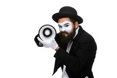Mime as business man with a megaphone. A mime as business man with a megaphone isolated on a white background. conceptual idea - to kill the word Stock Photography