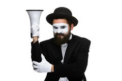 Mime as business man with a megaphone. A mime as business man with a megaphone isolated on a white background. conceptual idea - to kill the word Stock Images