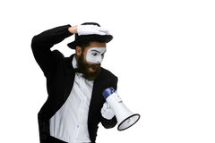 Mime as business man with a megaphone. A mime as business man with a megaphone isolated on a white background. conceptual idea - to kill the word Royalty Free Stock Photography