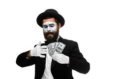 Mime as businessman holding money Royalty Free Stock Photo