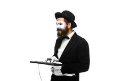 Mime as a businessman holdinga keyboard Royalty Free Stock Images