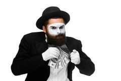 Mime as businessman putting money in his pocket Royalty Free Stock Photos