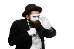 Mime as businessman putting money in his pocket Royalty Free Stock Image
