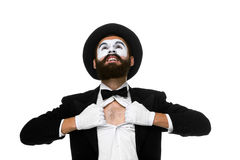 Mime as a businessman tearing his shirt off. Isolated on white background. Concept determination and courage Stock Photos