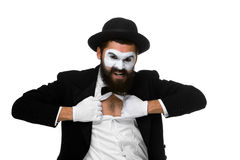 Mime as a businessman tearing his shirt off. Isolated on white background. Concept determination and courage Royalty Free Stock Images