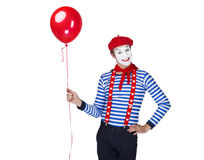 Mime with balloon.Emotional funny actor wearing. Sailor suit, red beret Stock Photos