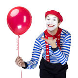 Mime with balloon.Emotional funny actor wearing Royalty Free Stock Images