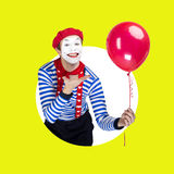 Mime with balloon.Emotional funny actor wearing Stock Image