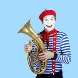 Mime with balloon.Emotional funny actor wearing Stock Images