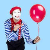Mime with balloon.Emotional funny actor wearing Royalty Free Stock Photography