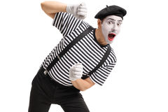 Mime behind an imaginary panel Stock Photos