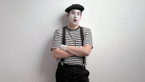 Mime being terrified. Mime leaning against a wall and being terrified stock footage