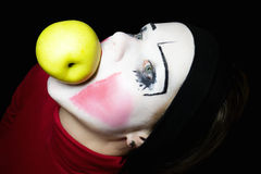 Mime biting an apple Royalty Free Stock Image