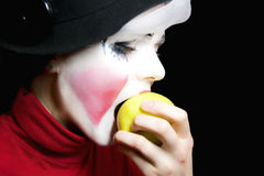 Mime biting an apple Royalty Free Stock Images