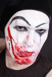 Mime with blood on face Royalty Free Stock Photos