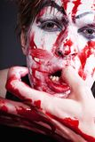 Mime with blood on face and hand Royalty Free Stock Images