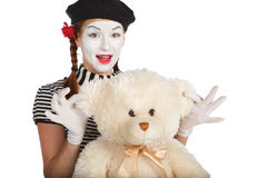 Mime comedian playing with teddy bear Royalty Free Stock Photos