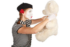 Mime comedian talking with teddy bear Royalty Free Stock Photo