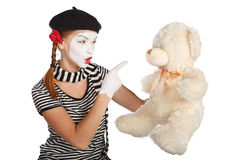 Mime comedian talking with teddy bear Royalty Free Stock Images