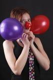 Mime con la nariz y los baloons rojos Imágenes de archivo libres de regalías