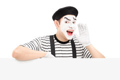 Mime dancer gesturing and shouting and standing on a panel Royalty Free Stock Image