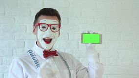 Mime with smartphone in hand in Green Background. Pantomime stock footage