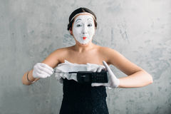 Mime female artist performing with mobile phone royalty free stock photos