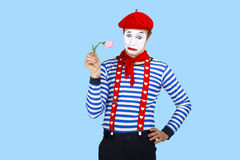 Mime with flower.Emotional funny actor wearing Royalty Free Stock Photo