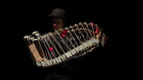 Mime game depicts the accordion. Black background stock video footage