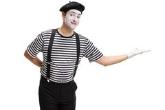Mime gesturing welcome with his hand royalty free stock photo
