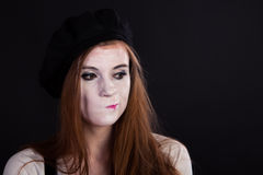 Mime Girl Displeased. A redhead mime girl looking sad and displeased stock image