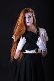 Mime Girl Hope. A redhead mime hopefully gazing Stock Photography