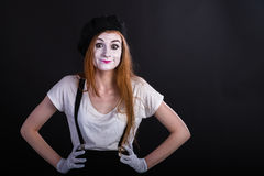 Mime Girl upset akimbo. A redhead mime upset in an akimbo pose Stock Photography