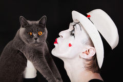 Mime with a gray British cat Royalty Free Stock Photos