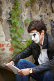 Mime guy reads his book Royalty Free Stock Photography