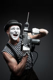 Mime with hammer drill Stock Photo