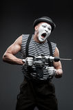 Mime with hammer drill Stock Images