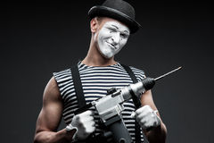 Mime with hammer drill Royalty Free Stock Photo