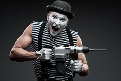 Mime with hammer drill Royalty Free Stock Image