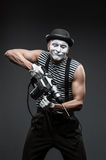 Mime with hammer drill Royalty Free Stock Images