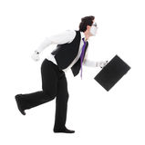 Mime with hand luggage runing. Isolated on white background Stock Photo