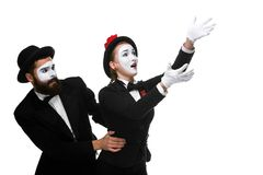 Mime holding another one up and running Stock Image