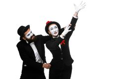 Mime holding another one up and running Royalty Free Stock Image