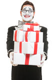 Mime holding many boxes of presents Stock Image
