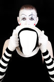 Mime holding white hat Royalty Free Stock Image